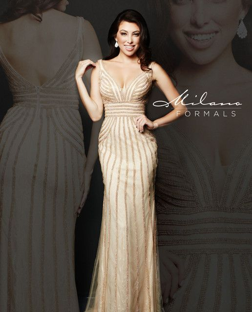 You'll look like a goddess in gold with this figure-hugging evening gown. Trumpet silhouette with sheer overlay is encrusted with gold beaded stripes. Flattering waist belt and deep V-neckline with sh