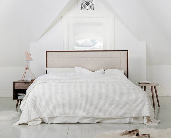 soft warm browns add to the gray and white bedroom