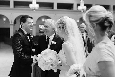 It's moments like these that make our heart melt! Take a look at this loving exchange between the groom and the father of the bride. Many thanks to Sunglow Photography and Aunnuciation Catholic Church.