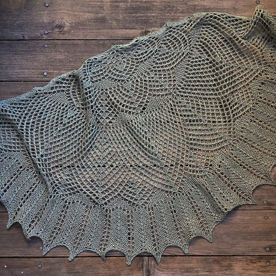 This hand knit shawl is made with a blend of 45% Wool/35% Silk/20% Nylon. This blend has a fabulous nubbly texture and deep, beautiful colors. You can wear it as a shawl with an elegant dress or as a