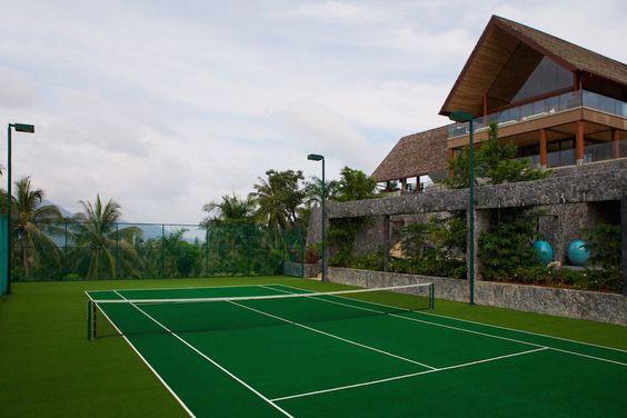 A tennis court with a tennis ball canon at Villa Praan. http://www.theluxurylisting.com/villa-praana-koh-samui/