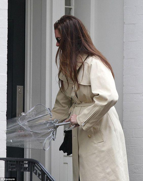 woman shaking off umbrella - Google Search