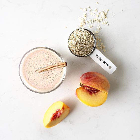 Peach Crisp Smoothie Ingredients: 1 large peeled peach sliced (or 1 c. frozen), 1/4 c. Oats, 1/2 c. Greek Yogurt, 1/2 c. Milk, 1/4 tsp. cinnamon and 4 ice cubes