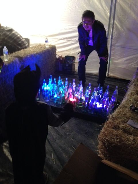 Coke Bottles/ Ring Toss/ Glow in the Dark bracelets for rings/ LED Lights/ Table flat on the ground with black plastic tablecloth