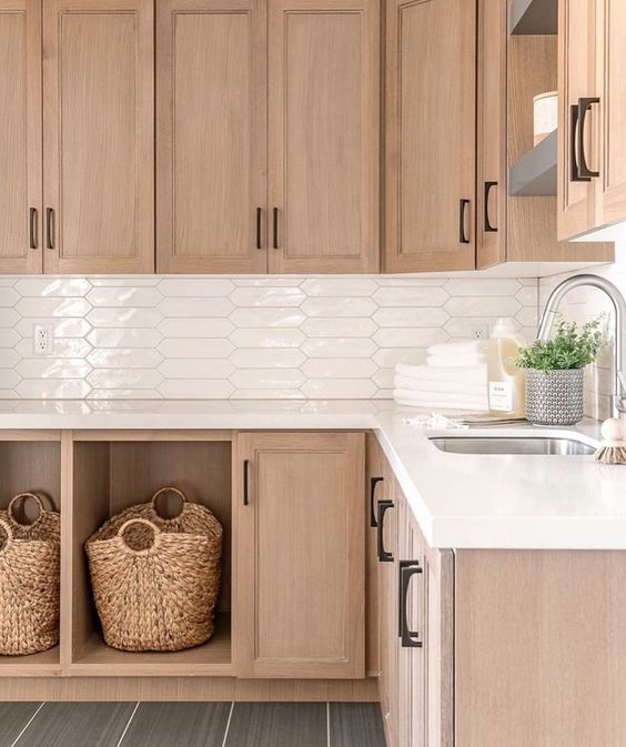 Homeowners love the look of wood, and natural cabinets are back in a big way   Designed by Remedy Furniture & Design   #laundryroom #laundryroomdesign #laundryroomdecor #mudroom #mudroomdesign #mudroomdecor #cabinets #customcabinets #rtacabinets #cabinetry #customcabinetry