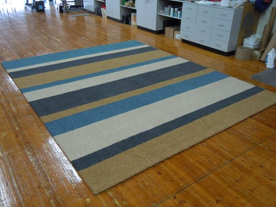 9'x11' living room rug custom-made from stripes of carpet.