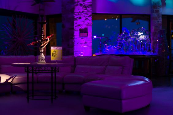 Hookah lounge at Top of the OASIS designed by Here to Help! and lighting by ILIOS