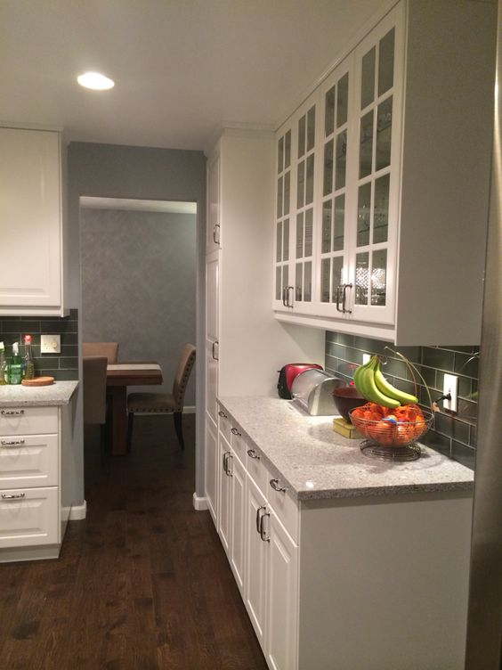 ikea white akrum cabinets with atlantic salt countertops original handscraped oak hardwood floors
