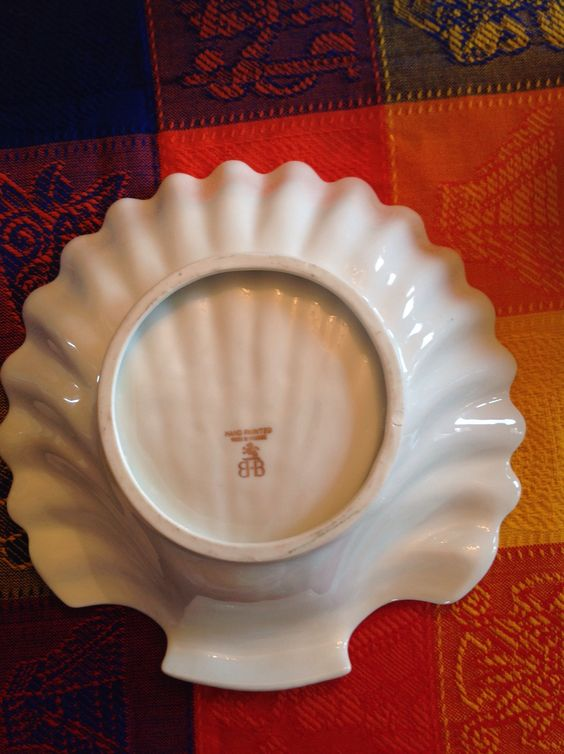 Ma k on bottom of large shell shaped serving bowl