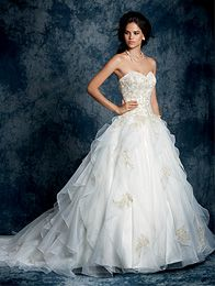 Alfred ANGELO Collection A Gorgeous Bride Wearing A Full Length, Ball Gown Silhouette, Classic Wedding Dress With A Ruffled Skirt And Lace Detailing.