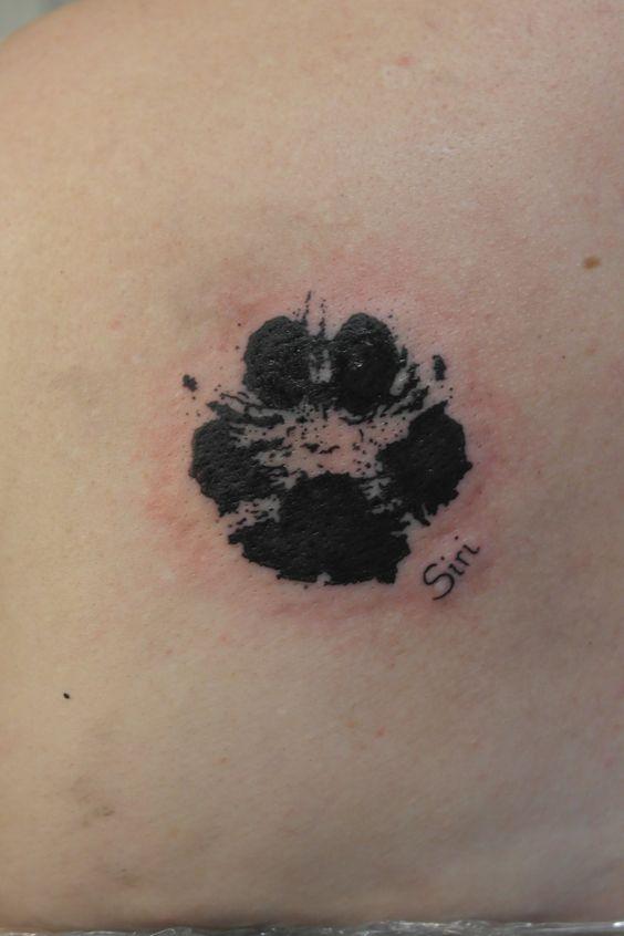 Realistic Dog Paw Print Tattoo