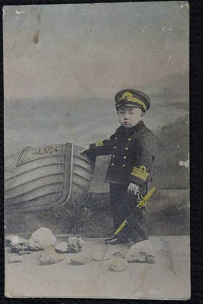 Photograph showing boy dressed in naval officer's uniform