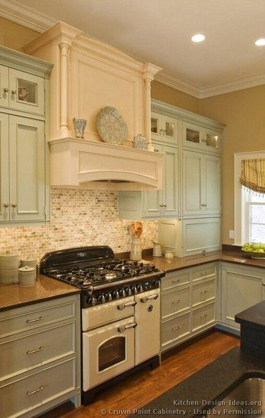 Vintage kitchen - so pretty -- love the cabinet colors and tile backsplash. Drawer pulls and knobs.: