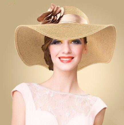 Ladies package wide brim straw hat UV flower design