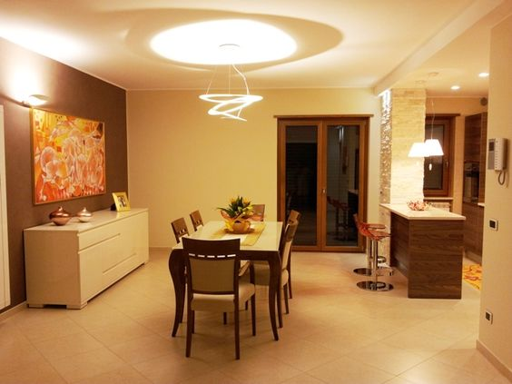 Dining room lighting with Artemide lamps (table and wall) and Luceplan kitchen island ...