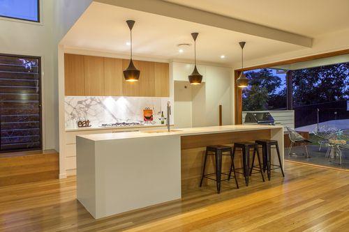 A kalka kitchen statuoria marble splashback blackbutt for Overhead kitchen cupboards