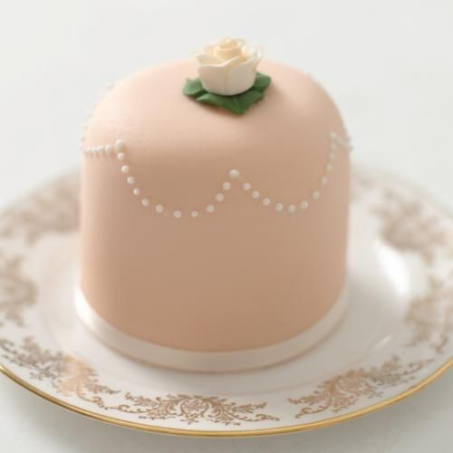 Peach colored rose and pearl miniature cake