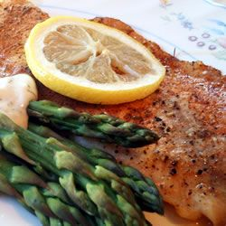 Baked tilapia seasoned with Cajun and citrus served with a creamy sauce of fresh dill and lemon.