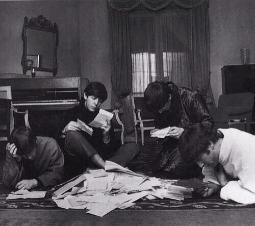 The Beatles reading and answering fan mail, 1964
