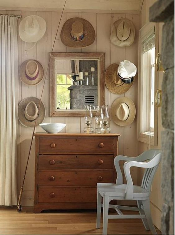 THats hung whimsically on hooks on whitewashed paneled wall with country dresser and banker's chair #SarahRichardson