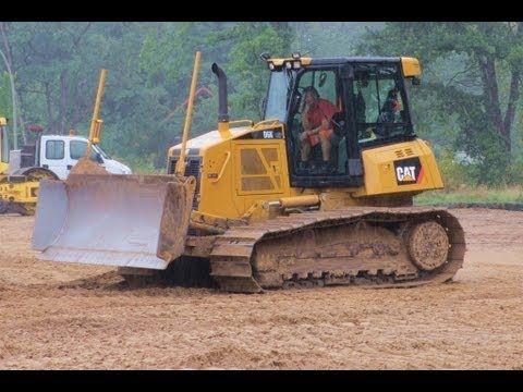 Caterpillar D6K LGP Bulldozer Planierraupe grading sand with laser