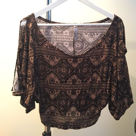 Flowy Open Shoulder Crop Top Comes down to the waistline, very light and flowy. Too broad in the shoulders for my narrow frame so I never got to wear it. No size tag but I would say it's a small. Voll Tops Crop Tops