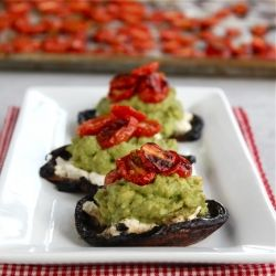 Grilled portobellos filled with goat cheese, avocado, and roasted tomatoes