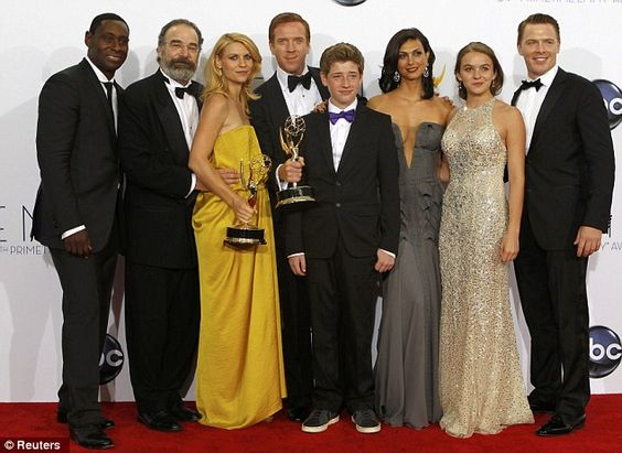 Winning cast: Danes, Lewis and the Homeland cast pose for a group shot backstage at the awards
