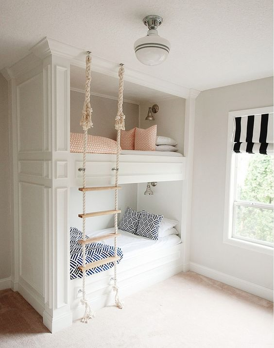 How adorable is this girls bedroom?! Stacked bunk beds with printed bedding, crown molding and a DIY rope ladder for climbing in and out of bed | Mikael Reeve Monson