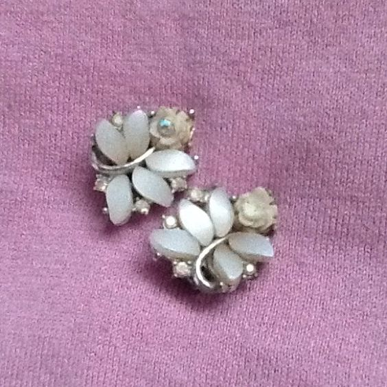 Pretty clip-on earrings Clip-on earrings, blush color. Has one rhinestone missing. Jewelry Earrings