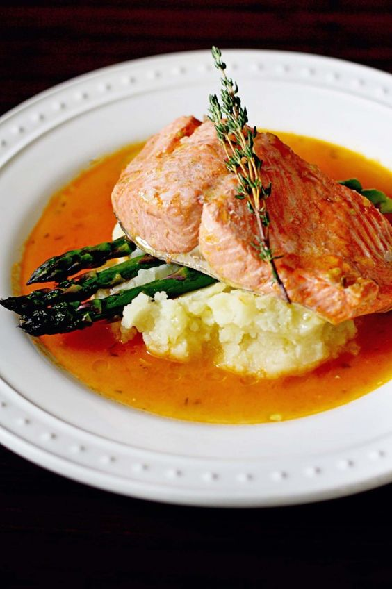 Copper River Salmon Poached in Tomato and Garlic Broth