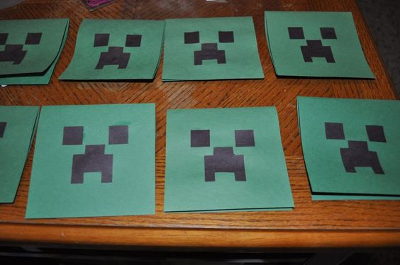 """Green construction paper with glued-on squares cut with scrap-booking punches.  The mouth is one bigger square with two strips trimmed on each side and moved down a notch.  The inside has a printed invitation, cut into a square and glued in.  It says """"It'sssssssssss (name)'s Birthday"""" based on the sound the creeper makes in the game."""