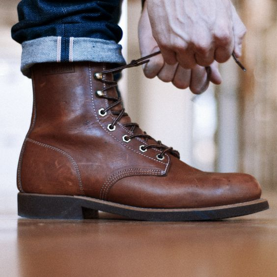 Great #leather boots with dark wash cuffed jeans. Talk about starting your day off on the right foot! #jeans #mensfashion