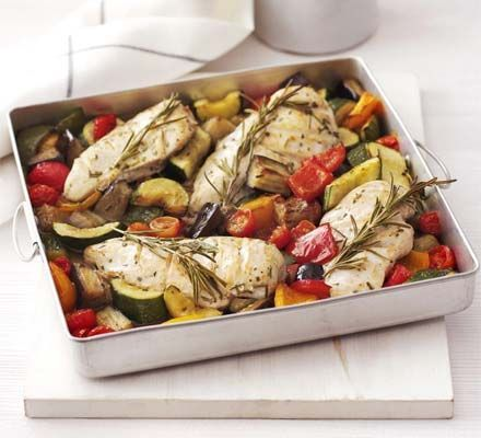 Rosemary chicken with oven-roasted ratatouille. You can't beat this low-fat, one-pot recipe for an easy meal, bursting with summer colour and flavour.