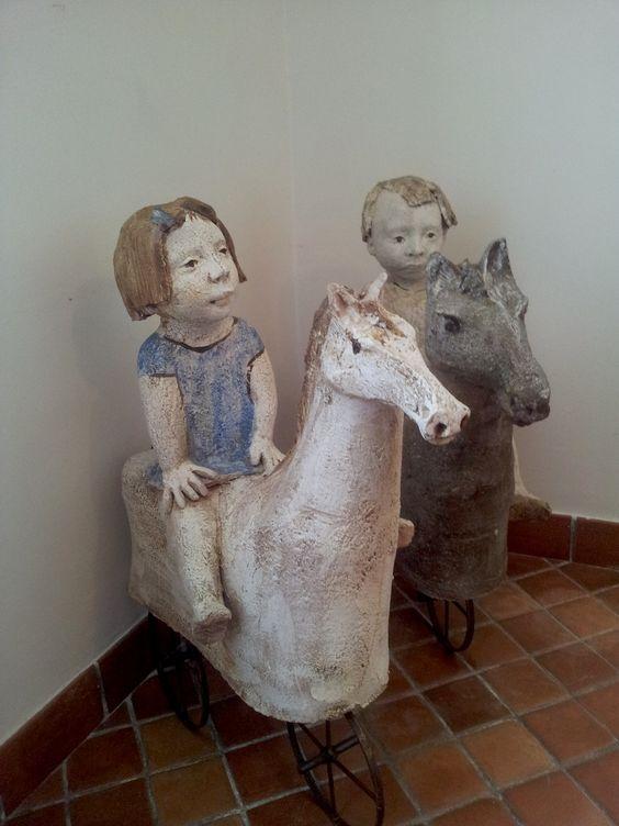 Blue - children - wooden horse - sculpture - T. Girones