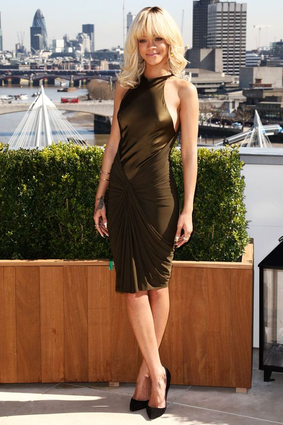 "Rihanna rocks an olive green Alexander Wang dress at an event for her new movie ""Battleship"" in London, England."