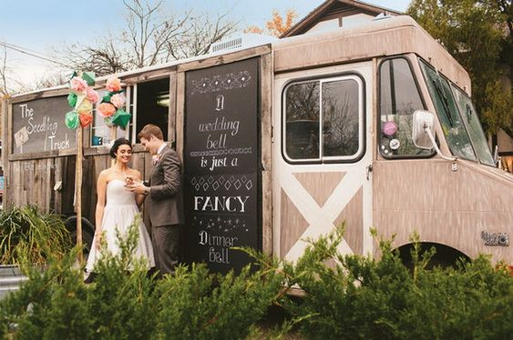 bride and groom with food truck