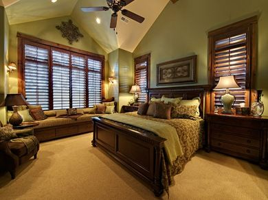 Isn't this bedroom warm and inviting? I love the green walls and the large window seat with the storage drawers below. I am a fan of large bedside tables with drawers especially in the master bedroom.
