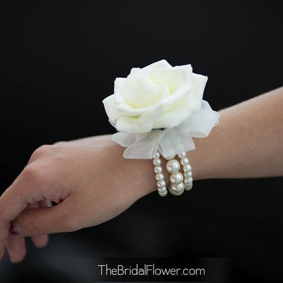 Wrist corsage simple cream ivory rose on a by TheBridalFlower