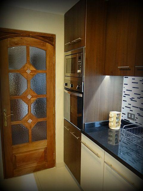 Mueble torre enchapado para horno microondas y horno Mueble para horno