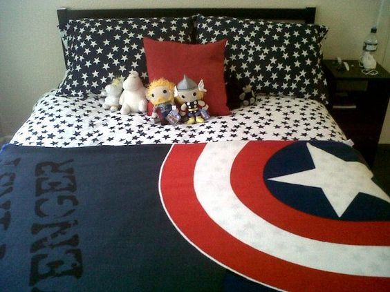 Avengers/Captain America themed bed! This is so cool! And I love the star sheet and pillows! <3