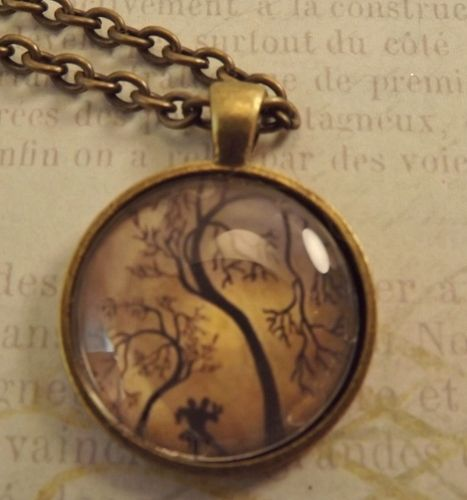 'Trees in the Golden Light Pendant Necklace' is going up for auction at  6pm Fri, Aug 31 with a starting bid of $6.