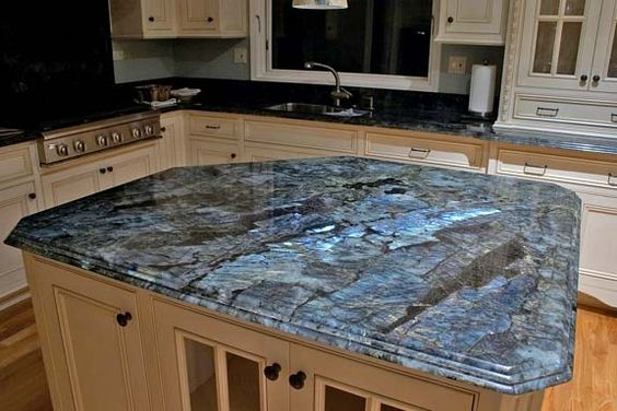 """Labradorite counter tops. Gives a blue """"flash"""" at certain angles. Perfect counter tops for a geology nerd like myself."""