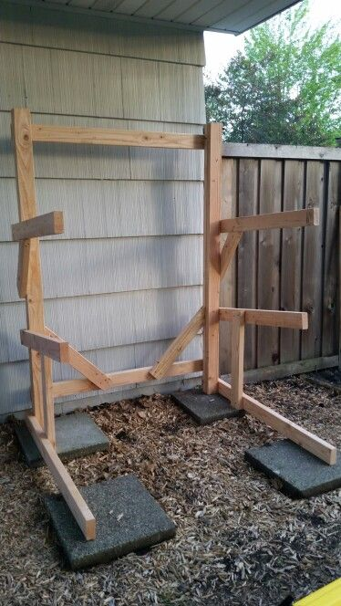 DIY kayak rack - easy to build in a couple hours. Built with 9 - 2x4s and a box of screws.
