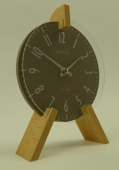 Like an artist's easel, this peg mantel clock in brown is a cute home accessory.