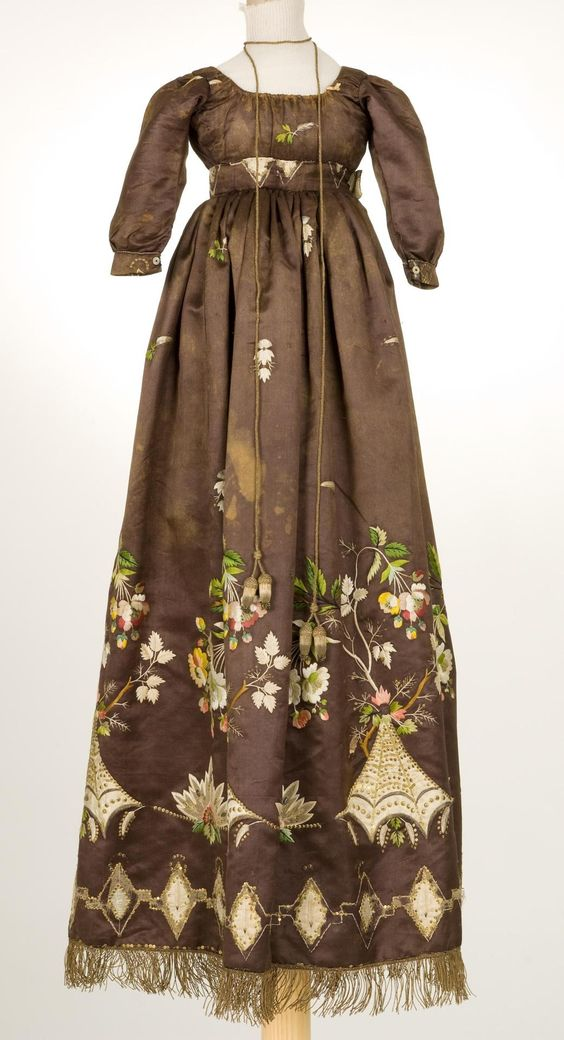 Dress--1800s.  The detail on this dress is so amazing!  Look at the fringe at the hem.  The embroidery is gorgeous.  Then, there is the cord used as a necklace or neck detail.: