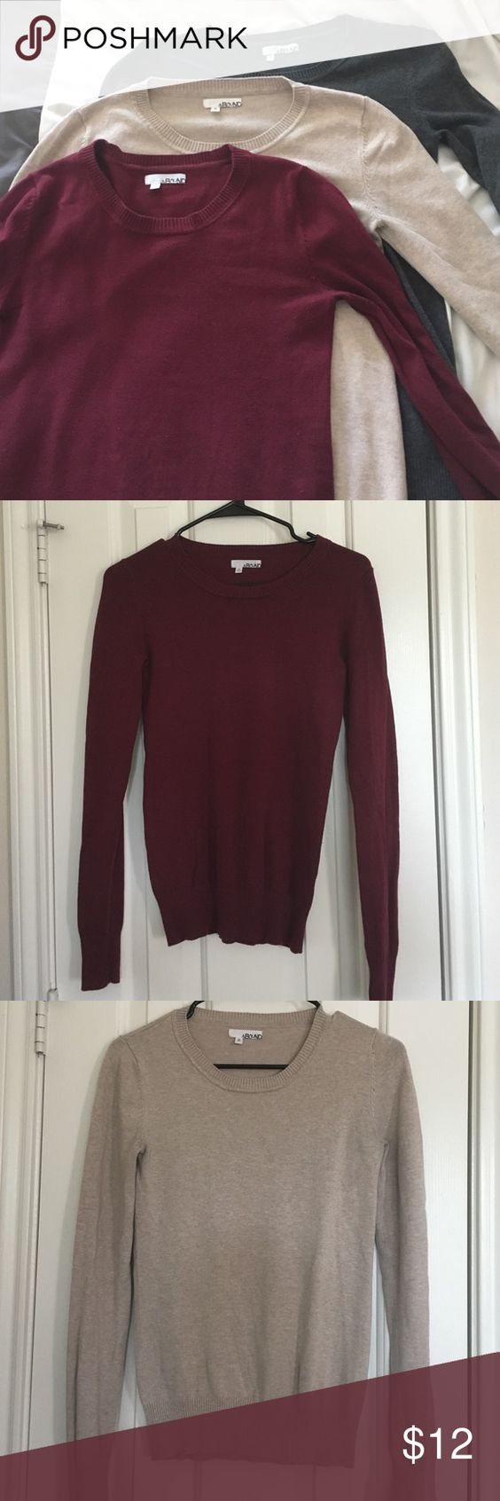 """3 Basic LS Sweaters - Sz M These were purchased from Nordstrom Rack. Colors are charcoal, beige and maroon. GUC; fabric does show wear in some places and the beige one has some slight discoloration under the arms from being worn with a black cardigan. Overall still good shape and no holes. Measurements: 23"""" shoulder to hem, 26"""" sleeves, 15"""" across armpits. Would likely fit a S/XS best. $5 individually or $12 for all 3.    📦✨Part of my closet-clean out sale - feel free to make offers and ask…"""