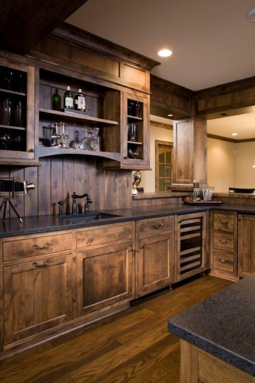 Here you've got a little more elaborate looking bar that really gives you plenty of space to entertain. Plus everything is wood and more rustic than you might think.