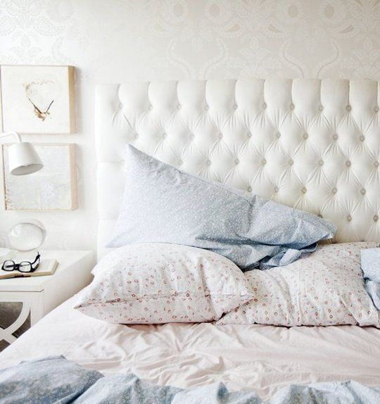 faux white leather headboard in Chesterfield design....liking this one loads