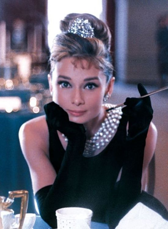 Breakfast at Tiffanys Audrey Hepburn. Another Hepburn classic. Moon River. Great New York scenes. It made me want to move to NYC at my first viewing.: